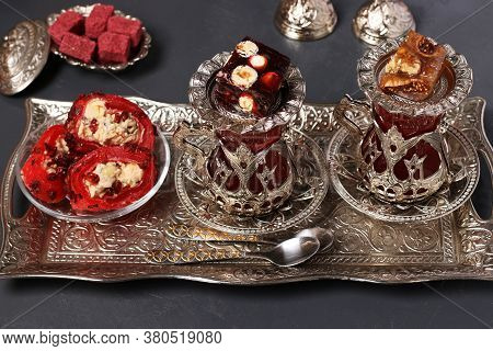 Turkish Armuds With Tea And Sweets On Metal Tray On Dark Background, Closeup, Horizontal Format