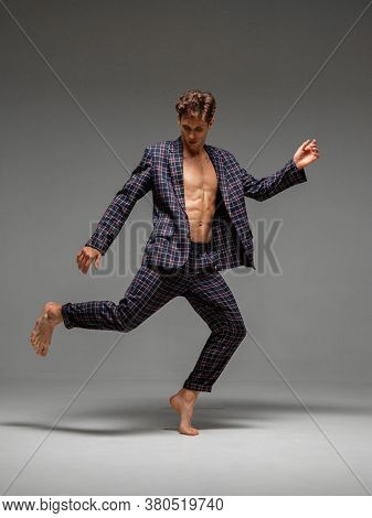 Stylish Young Man Dancer In Suit Dancing Modern Dance With Naked Torso In Studio. Dance School Poste