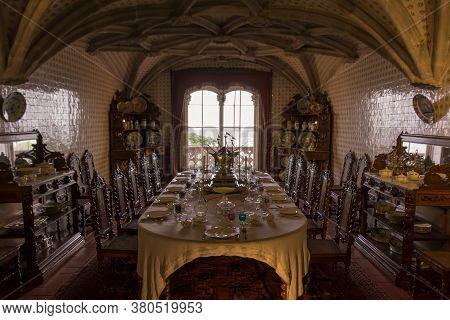Sintra, Portugal - 15th May, 2017: View Of The Royal Dining Room With Glass, Plates And Cutlery Neat