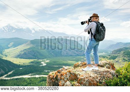 Woman Photographer Taking Photo At Mountain Peak. Hiker In The Mountains.