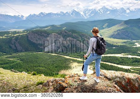 Woman With Binoculars Outdoor. Lady Hiker Relaxing On Top Of Hill And Enjoying View Of Valley.