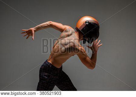 Handsome Guy Racer In Helmet Runs On Grey Background In Studio. Kart Racing School Poster. Body With