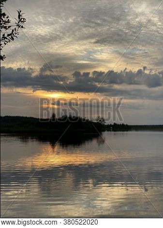 fishing boat docked in calm lake. wooden fishing boat in a still lake water. image of wooden fishing