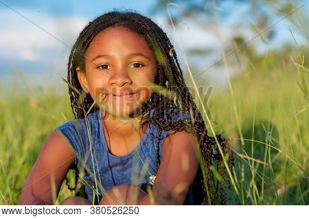 Portrait Of A African Girl Looking At The Camera