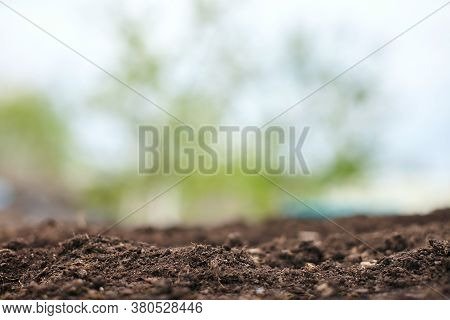 Spring Natural Soil Background For Planting Plants With Beautiful Bokeh. Preparing The Soil For Plan