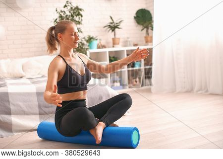 Woman Doing Exercise On A Special Simulator Balancer. Blonde Athletic Sportswear, Home Did Exercise