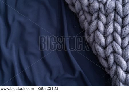 Bedding, Sheets Of Dark Blue Color, With A Gray Knitted Wool Merino Thick Blanket. A Copy Of The Spa