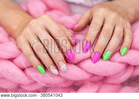 Lots Of Color Gloss Manicure Hands Has Different Blotches In Pink Background. Hands Wrapped In A Bla