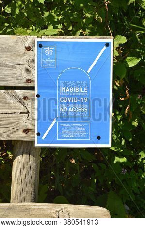 Val Alba Nature Reserve, Italy - August 9th 2020. A Sign In Both English And Italian On A Bench At T