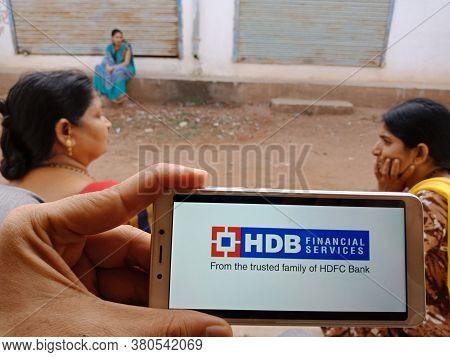 District Katni, India - June 02, 2020: An Indian Woman Holding Smart Phone With Displaying Hdb Finan
