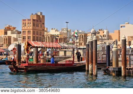 Dubai, Uae - December 9, 2017: People Ride Traditional Abra Ferry Crossing Dubai Creek In Uae. Dubai