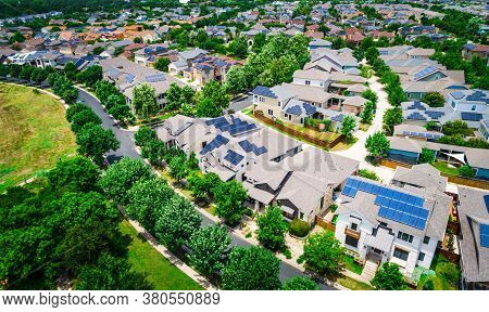 Aerial Drone Views High Above Suburb Homes With Solar Panel Rooftops And Clean Renewable Sustainable