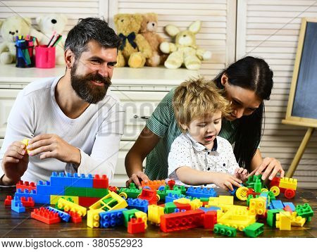 Young Family Spends Time In Playroom. Love And Family Games