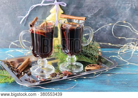 Christmas, Cups With Mulled Wine, Spices, New Year\'s Decor, Fir Branches, Illumination On A Wooden