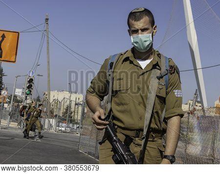 Jerusalem, Israel - August 6th, 2020: An Israeli Combat Soldier Wearing A Covid Mask In Jerusalem. T