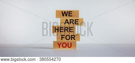 Wooden Blocks With Text 'we Are Here For You'. Beautiful White Background, Copy Space. Business Conc