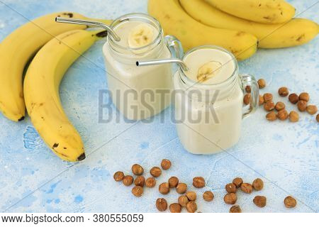 Banana Smoothie With Banana And Nuts. Tasty Vegetarian Food, Diet And Healthy Concept