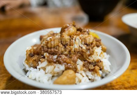 Taiwanese snacks of Chinese braised pork on rice on table