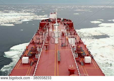 The Feed Of A Ship Sailing In The Arctic. Landscape Of The Arctic From The Deck Of The Tanker.