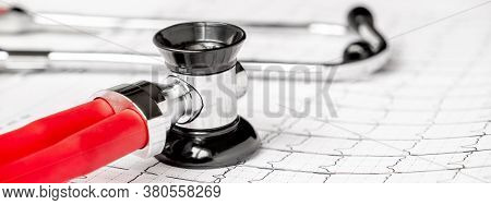 Photo Of An Electrocardiogram Ecg Or Ekg Printout With Stethoscope. Medical Health Concept. Ausculta