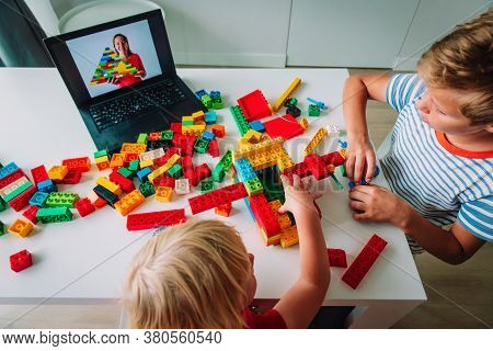 Kids Playing With Constructor At Home During Online Lesson. Remote Learning.