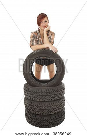 Woman With A Car Tyre