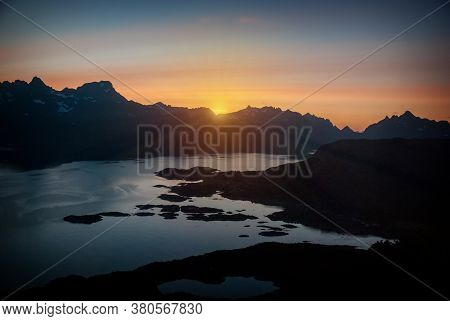 Sunrays Of The Midnight Sun Over The Mountains And The Sea