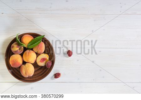 Banner With Peaches On A Whitewashed Wooden Background. The Peaches Are On A Brown Clay Plate. The V