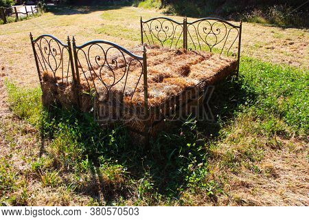 Rustic Bed Of Dried Hay Straw In A Tuscan Grass Field In The Rural Italy