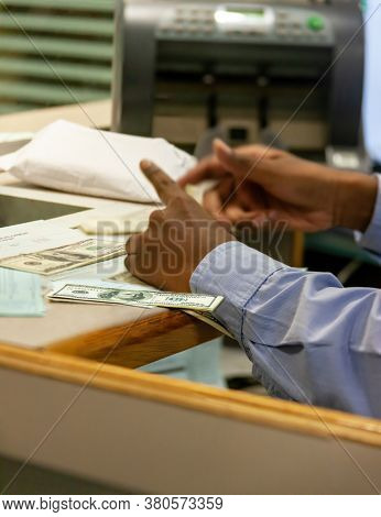 us dollar currency exchange of banknotes at a bank, African teller