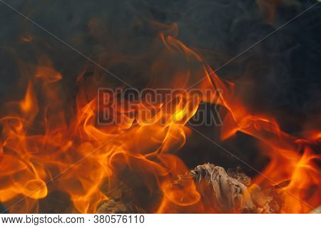 blazing fire background with tongues of flame