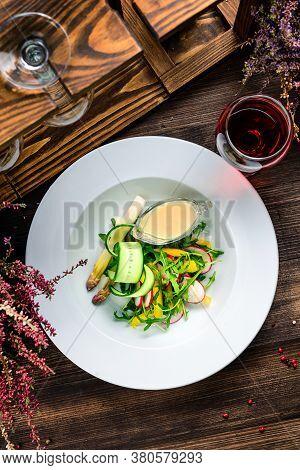 Bowl Of Rocket Salad And Sliced Radish, Fresh Summer Salad With Arugula And Radish