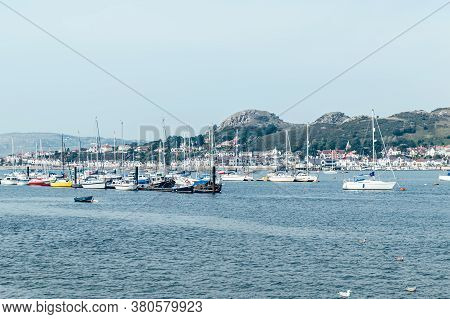 Conwy, North Wales, Uk - 09 August, 2020: Summer Day In Conwy Marina Near The Castle Located In Nort