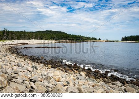 Trees Sand Rocks Urround A Cove In The Schoodic Peninsula In The Acadia National Park In Maine