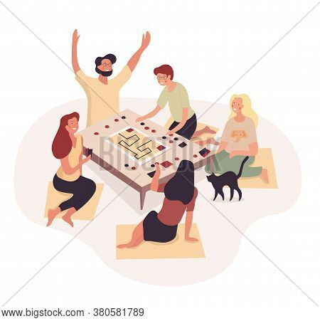 Group Of Young Friends Playing Board Games At Home Grouped Around A Low Table Cheering And Laughing,