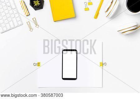 Workplace Mockup Top View. Mobile Phone On Blank Paper Sheet. Creative Designer Home Or Office Deskt