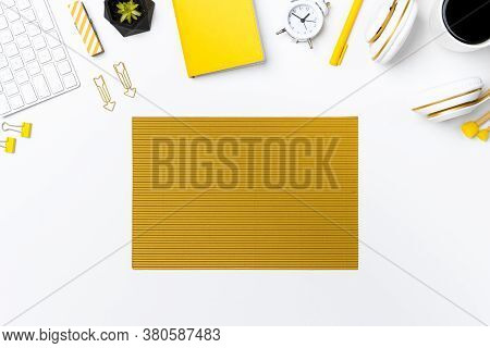 Flay Lay Of Office Desk With Crepe Paper On White Background. Top View Stationary Arrangement On Des