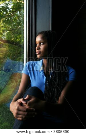 Beautiful Black Teenage Girl Reflected In The Window