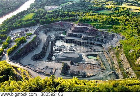 Aerial View Of Opencast Mining Quarry In The Middle Of The Forest