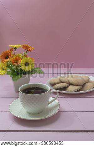Cup Of Americano Coffee And Homemade Pastries On Pink Background. Coffee Time, Romance.