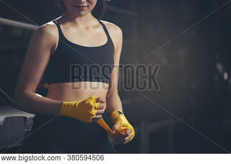 Fit Female Strap On Her Wrist And Exercise Hard To Strengthen Muscle.boxing Woman Prepare To Trianin