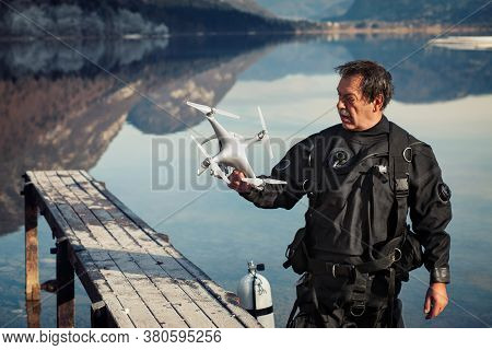 Drone Crash - Diver Holding A Rescued Drone