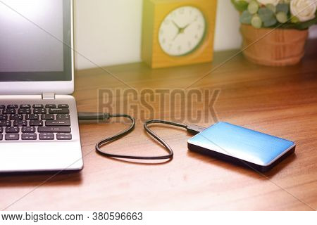 Portable External Hard Drive Usb3.0 Connect To Laptop Computer On Desk, Data Transfer Or Backup Pers