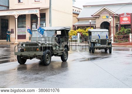Charters Towers, Australia - April 25, 2019: Returned Soldiers Driving Old Army Jeeps In Anzac Day P
