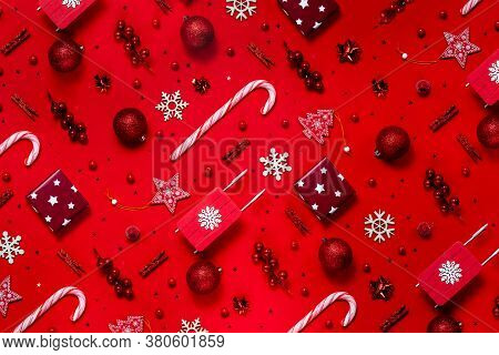 Trendy Christmas Pattern With Winter And New Year Toys On Red Background. Top Horizontal View Copysp