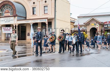 Charters Towers, Australia - April 25, 2019: School Children Marching In The Rain On Anzac Day Carry