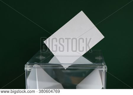 Voting Box With Bulletins On Green Background, Space For Text