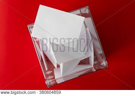 Voting Box With Bulletins On Red Background, Top View