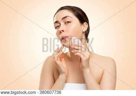 Gua Sha Massage. Portrait Of A Young Woman In A Bath Towel Makes A Gua Sha Massage In The Area Of Th