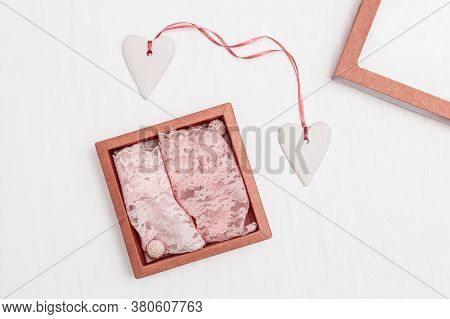 Pink Lace Panties In Gift Box With Two Wihte Hearts On White Background. Woman Fashion Lingerie For